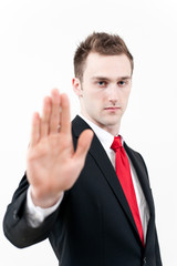 young businessman showing stop gesture