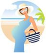 Young attractive pregnant woman on the beach