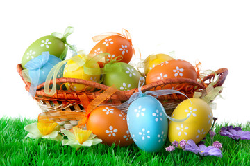color easter eggs in basket isolated on white