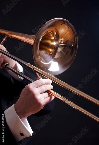 Leinwanddruck Bild Trombone on black