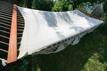 Croched spreader bar hammock in a garden