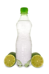 Bottle with mineral water and a green lemons.