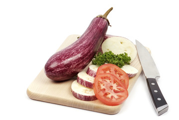 sliced aubergine and a knife