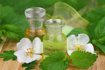 Fresh spa scene with essence of roses and lemon balm