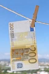 money on a linen cord