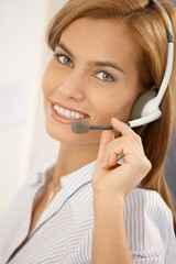 Portrait of confident call center girl