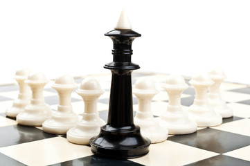 king and powns on chessboard