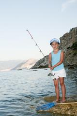 Fishing -  girl fishing at the beach