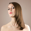 Beautiful face of young woman with pearl necklace.