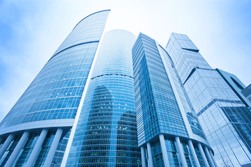 futuristic structure of office skyscrapers in the morning, wide