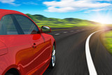 Fototapety Red car driving by autobahn in sunset with motion blur