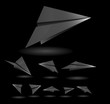 black paper planes isolated on black background