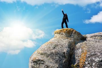 Man on the peak of mountain.
