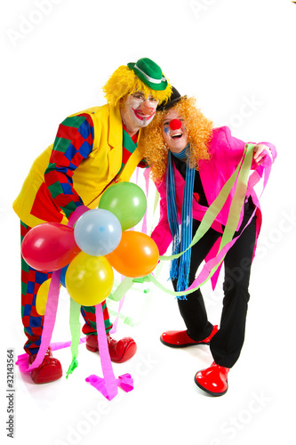 Funny clowns with balloons