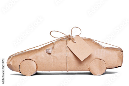 Car wrapped in brown paper cut out - 32144178