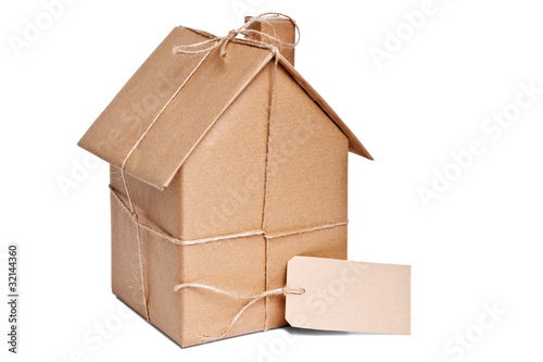 House wrapped in brown paper cut out - 32144360