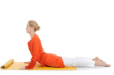 series or yoga photos. young woman in cobra pose on yellow pilat
