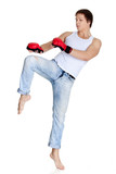 Sporty man  in red fighting gloves.