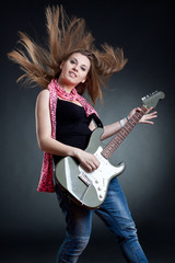 headbanging woman guitarist playing her guitar