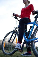 pretty young female biker outddors on her mountain bike