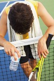 Tennis Player Alone On A Court