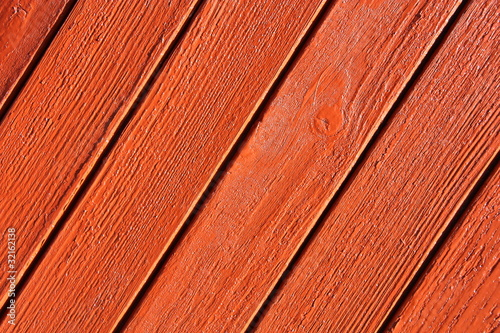 Wall of rough wooden planks.