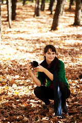 beautiful y girl with a camera