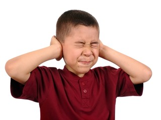 child protecting ears from loud noise
