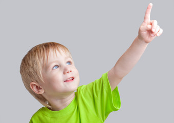 Boy points to something