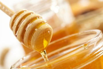 Honey with wood stick