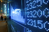 Stock ticker board at the stock exchange poster