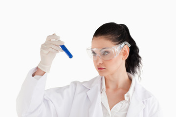 Dark-haired scientist carrying out an experiment