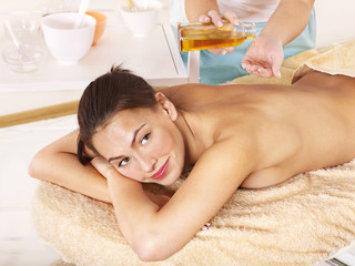 Young woman on massage table in beauty spa. © Gennadiy Poznyakov