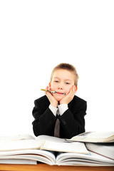 carefree schoolboy in classroom isolated over white background