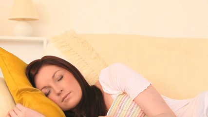 Attractive dark-haired woman taking a nap