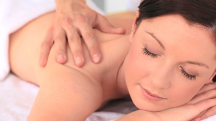 Attractive brunette enjoying a massage