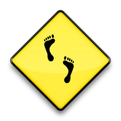 yellow and black caution sign with foot print - no bare feet