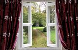 Open window to a church garden - 32192579