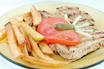 Grilled chiken steak with fried potatoes and vegetab