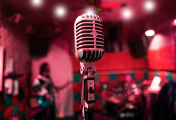 musical background with music band and vintage microphone