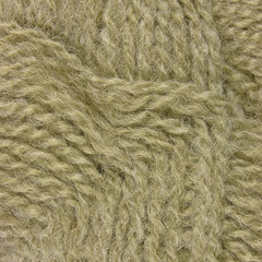 Natural beige fine wool threads texture clew macro closeup