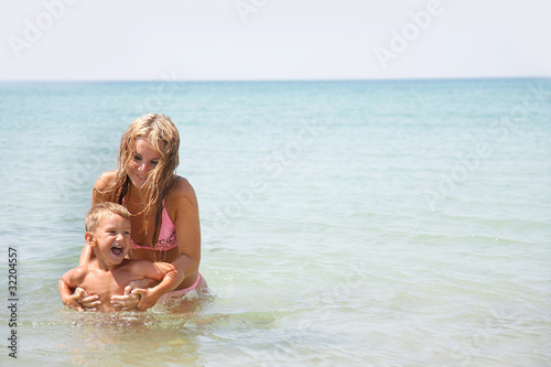 mother and son playing in water