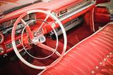 classic car interior with red leather upholstery