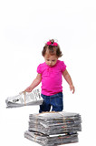 Toddler carryinga stack of recyclable paper