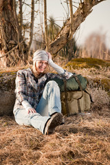 Camping young woman in countryside backpack relax