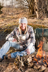 Campfire hiking woman with backpack cook countryside