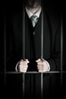 Businessman in prison cell