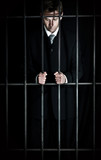 Businessman behind bars