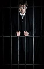 Businessman behind bars