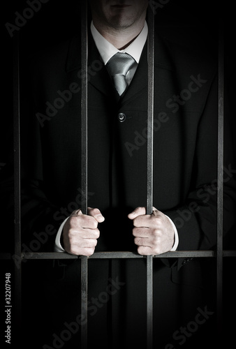 Businessman in prison cell